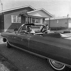 Louisville, Ky. — Clay prepares to take his mother, Odessa Grady Clay, for a ride in a new Cadillac convertible on April 4, 1963.