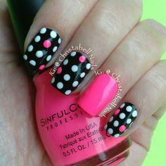 Pink white and black polka dot nails