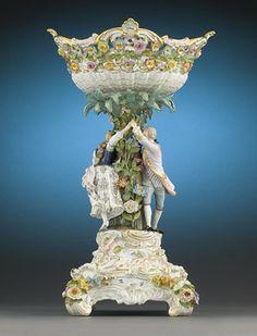 This monumental Meissen porcelain basket centerpiece is a joyous celebration of the Rococo style. 1875