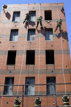 Firefighters practice rope slides at the Fire Academy.  shared by NY Firestore