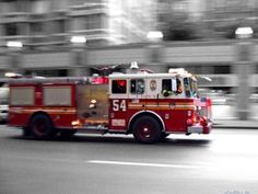vehicle,rescue,emergency,bus,police,ambulance,transportation system,siren,car,truck,paramedic,traffic,accident,blur,outdoors,action,firehouse,road,police squad