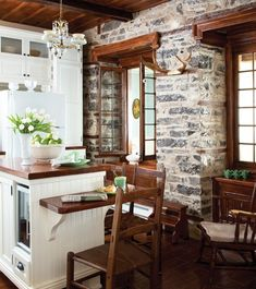I like the lowered table top, and that the countertops are wood... and the cabinets are white.... and the bricks.... and the antlers : )