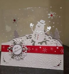 Die'sire snow man.  Century pearl card and snowy acetate etc were used to make a Christmas card for the grandchildren. Cute card for cute kids.