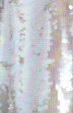 iridescent | mother-of-pearl | gleaming | shimmering | metallic rainbow | shine | opalescent | Iridient |
