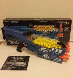NERF Rival Nemesis MXVII-10K Blaster - Blue Team    Pulled from store Box have minor damage but gun is in mint condition    Comes with user manual    No scratch full working condition    Batteries not included.     96 round of dart included    Please check detailed photos    | eBay! #nerf #nerfgun #nerfrival #nemesis #rivalnemesis #nerfmoding #nerfmodding