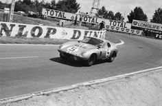 Dan Gurney powers the original Cobra Daytona Coupe out of Arnage during the 1964 24 Hours of Le Mans. The car would finish overall and in GT. Le Mans, Shelby Daytona, Dan Gurney, The Great Race, Gilles Villeneuve, Carroll Shelby, Ac Cobra, American Motors, Mustang Fastback