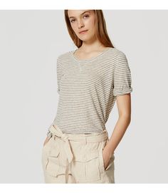 "These linen cotton shorts pack a safari-chic punch - and finish on a femme note with a pretty waist tie. Zip fly with button closure. Belt loops. Waist tie. Front button flap patch pockets. Side welt pockets. Back button flap pockets. 4"" inseam."