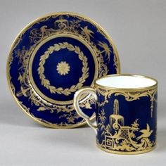 A Sèvres Porcelain Cup & Saucer, circa 1785  This gobelet Litron et soucoupe of the 2nd size is decorated with splendid gilding over a bleu nouveau ground.