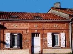 Toulousaine, petite maison de plein pied faite de briques et de galets de garonne