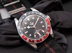 The Tudor Black Bay GMT was unveiled the same day as its parent company, Rolex, unveiled the GMT-Master II with jubilee bracelet. Dream Watches, Luxury Watches, Cool Watches, Watches For Men, Tudor Heritage Black Bay, Tudor Black Bay, Tudor Submariner, Suit Shoes, Watch Companies