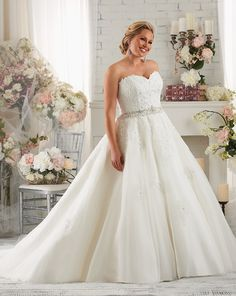 Bonny Bridal Dress #1419, sequined lace and beading wrap around the waist into a full A-line skirt. Find this beautiful plus-size wedding gown in the Reading Bridal District only at Belle Bridal Boutique
