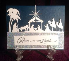 Peace on Earth Stampendous Heavenly Swirl stamp, Memory Box Starry starry Night stencil, Taylored Expressions Nativity Border die.  Christmas