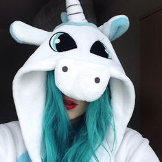 So annoyed at the moment so I'm going to reminisce about my days with turquoise @manicpanicnyc #manicpanic hair and a unicorn onesie!