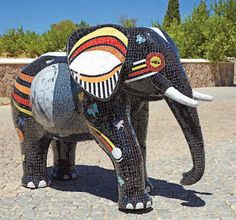 Mosaic Elephant A unique and stunning sculpture. Originally hewn in Polystyrene then fibreglass. The artist Ivan Ulmann then transformed the elephant into this beautiful piece by meticulously selecting each mosaic tile, cutting and angling it to fit perfectly. The process can take up to 6 months. Available in the UK from Seegir www.seegir.com