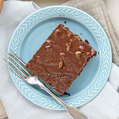 Learn how to make this delicious Texas Sheet Cake with a homemade chocolate cake layer topped with chocolate frosting and chopped toasted pecans.