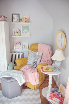 colours of the room. small details that make a big impact is just what I want for my babies nursery soft and sweet. Especially with an awesome reading corner