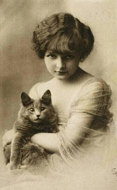 Pretty little girl with her cat, 1922