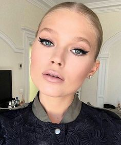 Gorgeous Vita Sidorkina with cat flick eyeliner and pink lipstick makeup.