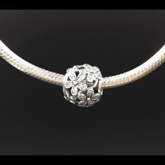 """Pandora Charm New Pandora """"Daisy"""" charm. Sterling silver with clear cubic zirconia. Properly hallmarked S925 ALE. Pandora box not available. No trades or pp. Thanks and happy Poshing!! Pandora Jewelry Bracelets"""