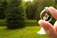 Creative photo through the bride's engagement ring.