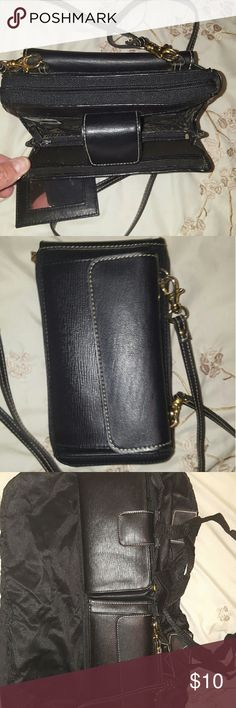 Purse/Tote Bag This is a purse and it has pockets on each side to put stuff in and if you need a tote bag the middle section unzips and it folds out to one. Pretty handy and different. Used a couple times. Great condition. Bags Crossbody Bags
