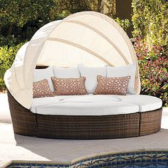 Frontgate circle lounger, pulls apart into extra seating. want. $2195 #outdoor #lounger #backyard