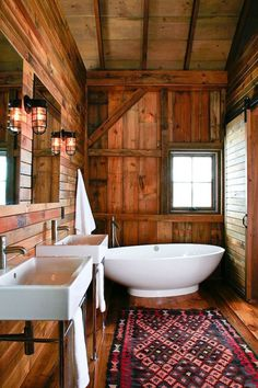 so simplistic rich and warm.  Love the soak tub, the shiplap, and exposed beams