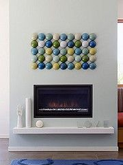 Modern circles fireplace.  Think of all the things that could be lined up like this!