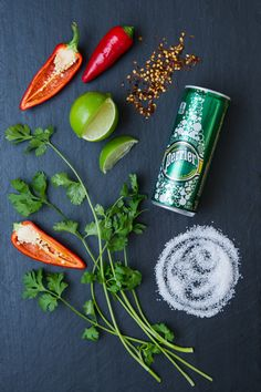 Need a warm fuzzy feeling this holiday season? Perrier's here to help. Try our Spicy Cilantro Margarita. You'll need: Fresh cilantro leaves from 2 stems, fresh red jalapeno pepper—thinly sliced (careful not to touch or include the seeds, they are ferocious), red pepper chili flakes for garnish, coarse sea salt for glass rim, 2 oz. tequila, 1/2 oz. agave syrup, 1 oz. fresh lime juice and lime wedges for garnish, Perrier® Original Sparkling Natural Mineral Water. The recipe continues on the…