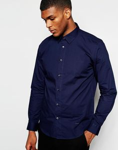 """Smart shirt by Wincer and Plant Crisp, woven cotton Contains stretch for comfort Point collar Button placket Slim fit - cut closely to the body Machine wash 98% Cotton, 2% Elastane Our model wears a size Medium and is 188cm/6'2"""" tall"""