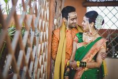 Dressed in traditional Maharashtrian outfits in kesari and green complementing outfits Indian Wedding Poses, Indian Wedding Couple Photography, Pre Wedding Poses, Bride Photography, Pre Wedding Photoshoot, Wedding Photo Pictures, Wedding Couple Photos, Wedding Pics, Wedding Couples