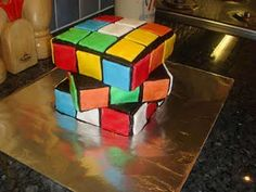 Rubiks Cube Cake.  This is pretty cool. I want my brother to have a party so that I can make this cake!!!!!!