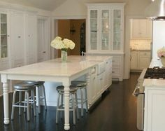 I like the opening on the end for all the stools..reminds me of our old house...also love the tall white furniture like piece at end with glass..this is what I want for our kitchen!!!West End Cabinet Company: Plain & Fancy Photo Gallery