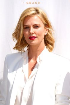 Charlize Theron's matte red lip. See it and 9 other pretty celebrity spring beauty looks worth trying.