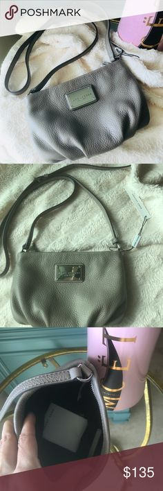 Marc Jacobs NWT!! Authentic Marc Jacobs crossbody/messenger bag. Adjustable strap. Soft leather in cement color. Hardware in silver color. Stylish and chic all year use. Tag attached! Marc Jacobs Bags Crossbody Bags