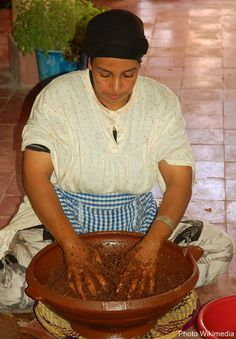 Traditional production of argan oil in Morocco, in the region of Souss