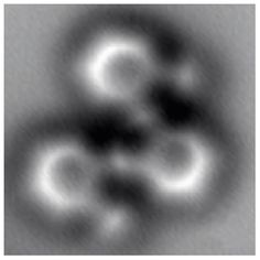 First-ever high-resolution image of a molecule as it breaks and reforms chemical bonds. Image made by using a noncontact atomic force microscope revealing the positions of individual atoms and bonds in a molecule having 26 carbon atoms and 14 hydrogen atoms structured as three connected benzene rings