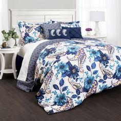 Pairing blue blooms and a bold paisley print, this comforter set adds a stylish finishing touch to your master suite or guest room.