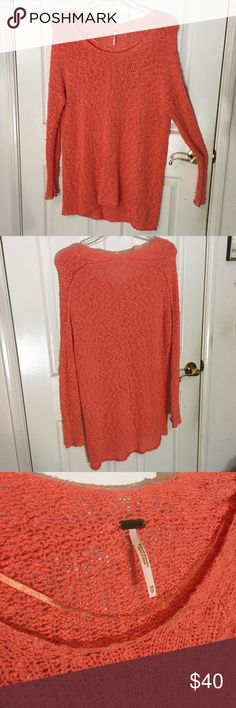 """FP Coral Loose Knit Tunic 🍊🍋🍉 OFFERS WELCOME The loose-knit """"shaggy bear"""" popcorn material and bright coral color make this lightweight, oversized sweater from Free People PERFECT for spring! 🌺 Featuring a scoop neck, dolman sleeves, and exposed seam along the back, this high-low tunic mimics the look of spirit jerseys.  GUC, some minor wear/fading along neckline (pic 3), but it's hard to see 90% cotton, 10% nylon XS, but oversized and could fit larger sizes.  GREAT for tall ladies! L…"""