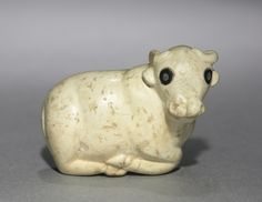 Amulet Seal in the Form of a Bull, c. 3250 BC Pre-Sumerian, Iraq, C. 3250 BC  limestone with black stone inlaid eyes