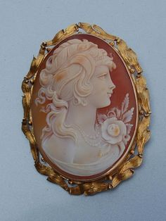 Italian Cameo ... In days past...before photography, people had their images or images of loved ones carved on shell and wore them as pendants, rings and pins....it is a dying art, as few young people are willing to study under the master craftsmen to learn this beautiful skill...