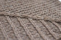 The Ambrosia cowl is worked in the round as a seamless tube. The two textures of…