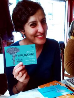 Karolyn with ours invitation cards:  An unimaginable woman