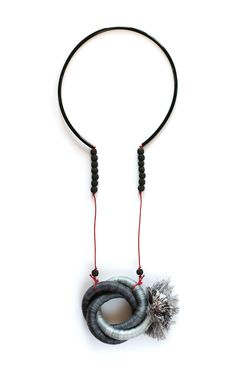 Kalina Filcheva, ¨Parallel universes¨ Necklace: industrial rope, steel, microfiber thread, waxed cord, rubber tubing, lava stone. .  .