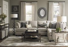 Custom Upholstered L-Shaped Sectional by Bassett Furniture. Design your own sectional by specifying a frame size; arm, base, cushion and back styles; and one of many fabrics.