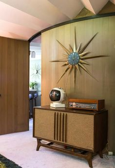 "A 1960s ""dingbat"" clock and living room console"