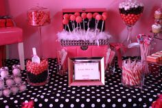 I LOVE the feather boa accent where the cake pops are displayed.
