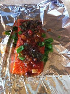 Honeyed - salsa salmon with black pepper and green onions.  1 fillet salmon,  2 tsp organic honey,  2 tsp Caribbean salsa,  blk pepper to taste,  2 stalks green onion, other seasoning to taste. Pierce salmon with fork for honey and salsa to penetrate, loosely wrap in foil and allow to marinate for a couple of hours, bake for 20-25 min or until flakes easily