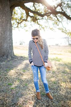 distressed jeans, striped tee, cognac cross body, cognac suede ankle booties