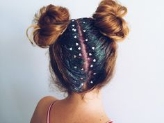 Two hair buns styled with glitter paste and heart confetti